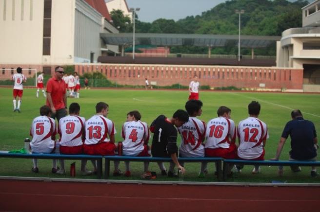The boys Varsity soccer team taking a break during a match. Photo taken by Kristiyi-Marie Clark