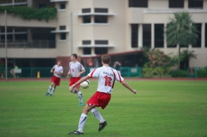Varsity Soccer player Ian Arzel (16) passes the ball to a team mate during a match. Photo taken by Andrew Choo