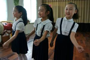 Seven-year-olds practice music and dance at the Schoolchildren's Palace in Pyongyang.