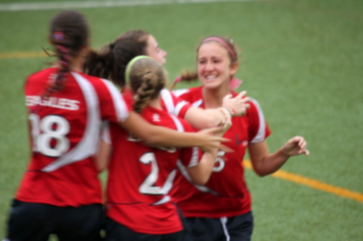 Celebrating the first goal in the championship game, Emma Gordon, Bailee Nelson, Paola Hoffer, and Eliza L'heureux run together in celebration. Photo courtesy of Linda Spitsen.