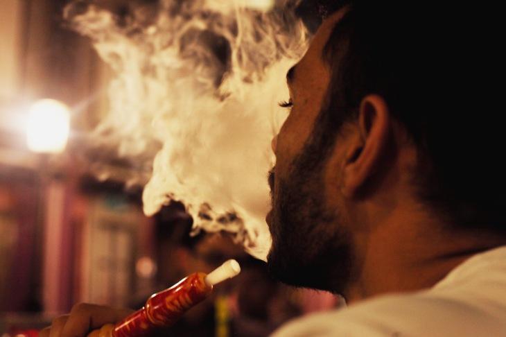 A shisha smoker at a popular café, captured by Rachael Hyde,