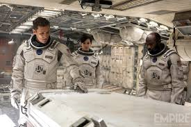 Lead actors Matthew McConaughey (Far Left) and Anne Hatthaway (Middle) in their state-of-the-art space ship.