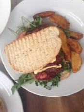Sirloin Steak Sandwich: served with potato wedges, fresh rockets and tomatoes. Photo by Mallari Batlaw