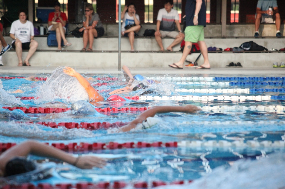 Varsity swim team girls begin the race with the 1,000 meter swim.