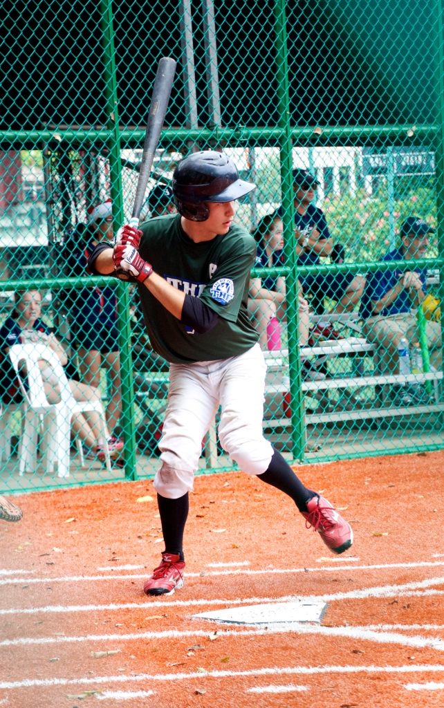 Another player taking turn at bat
