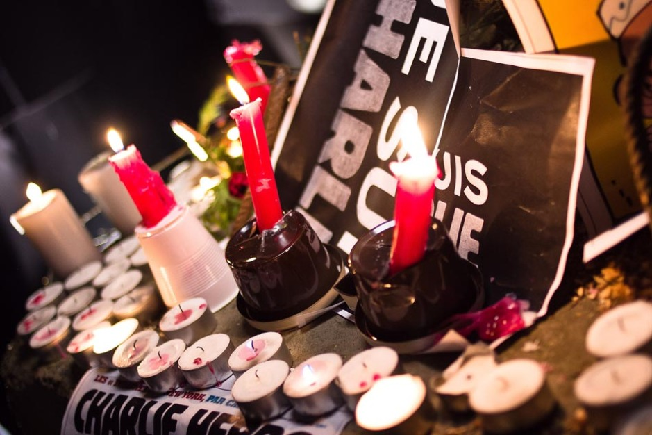Candles and posters showing support for the deaths at Charlie Hebdo line the streets of Luxembourg on Jan. 7. Photo by Valentina Calá, creative commons license.