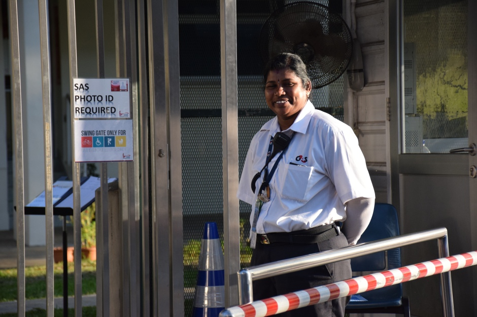 An SAS back gate security  guard smiles for a photo. Photo by Janna Agustin.