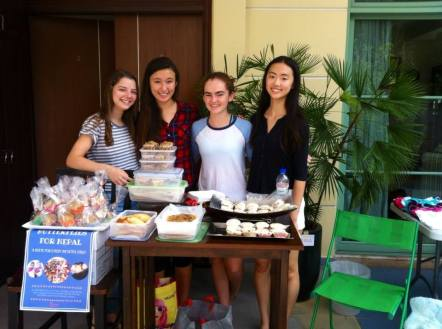 Sarah Du and members of the Butterflies for Nepal service club hosting a bake sale.