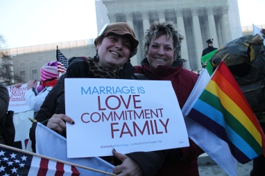 Just two of the many LGBT rights activists crowded in front of the U.S. Supreme Court in support of same-sex marriage (Creative Commons License).