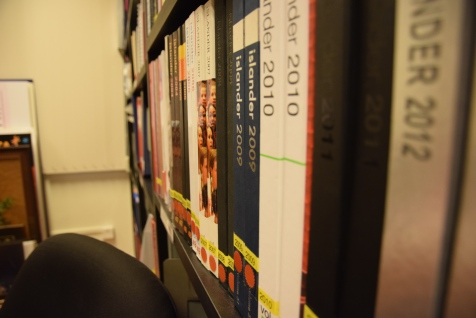 The shelves in the Archives are lined with copies of every Islander volume since 1958. (Photo by Sheyna Cruz)