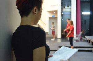 Karisa Poedjirahardjo reads her script backstage before she goes onstage. Photo by Hayden Reeves.