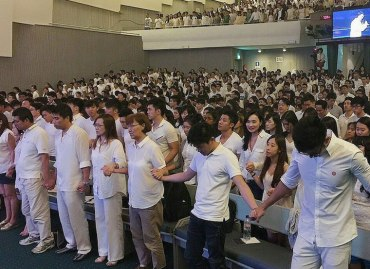 Parishioners of the Faith Community Baptist Church in Singapore gather for a sermon led by Paster Lawrence Khong (http://mothership.sg/2015/06/pastor-lawrence-khong-we-will-wear-white-until-the-pink-is-gone/).