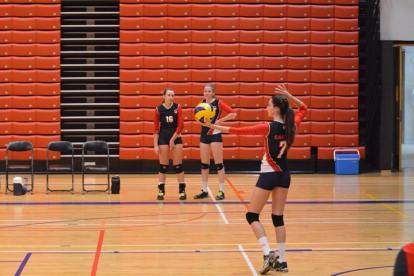 Miranda Schot sets up a serve in a Varsity volleyball game Photography by Ursula Pong