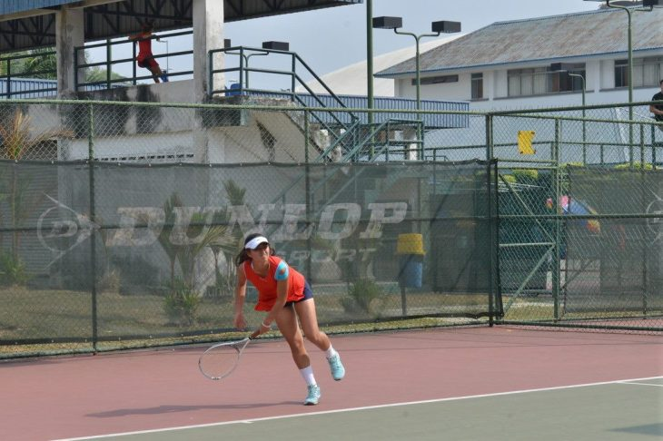 Zoe Adamopoulos playing tennis her Freshmen year. Photo by Zoe Adamopoulos.
