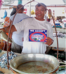 Local vendor shows he accept Wagan. Photo by Joey Renert