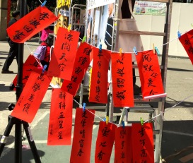 Handwritten door couplets hung for sale at Victoria Park Flower Market.