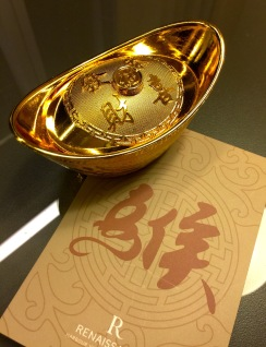 "Chinese ""gold money"" with chocolate inside, traditionally shared with friends and families for celebration with the Chinese character ""猴,"" meaning monkey."