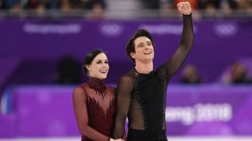 Tessa Virtue and Scott Moir after their Olympic Gold winning performance. Photo taken from Newswoof Canada.