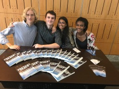 Junior Lukas Daniel-Pedersen and seniors Bobby Fuller, Anjali Mehta, and Alana Moshay (L-R) sell copies of Present Tense Future at the official book launch of Present Tense Future