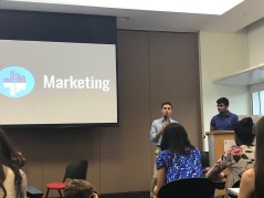Seniors Aidan Fry and Aryaman Gulati (L-R) discuss the process of marketing Present Tense Future at the official book launch of Present Tense Future